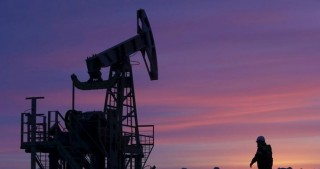 Oil prices keep a grip on rally after OPEC deal; Brent atop $52 a barrel