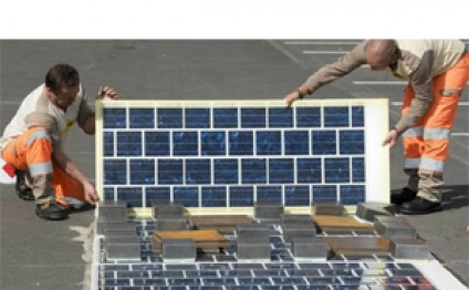 Road paved with solar panels powers French town