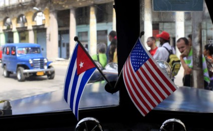 Cuba says Obama welcome to visit but not to meddle